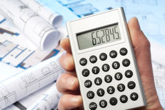 Calculator and blueprints Stock Image