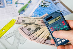 Calculator on a blurred background of the project and dollars Stock Photo