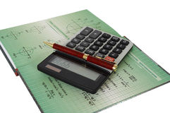 Calculator  and  book Stock Image
