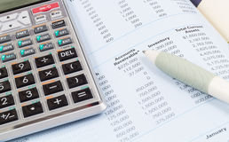 Calculator , book and pen Stock Photos