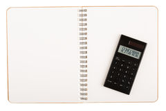 Calculator on book with spiral wire Stock Photography