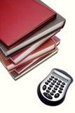 Calculator and books stock photo