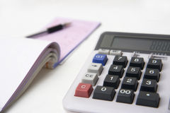 Calculator  and books on white Stock Image