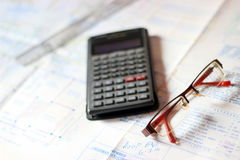 Calculator and building plans. Stock Photography