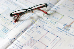 Calculator and building plans. Stock Photo