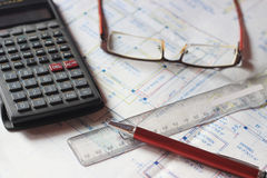 Calculator and building plans. Royalty Free Stock Photo