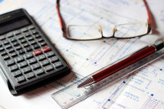 Calculator and building plans. Royalty Free Stock Photos