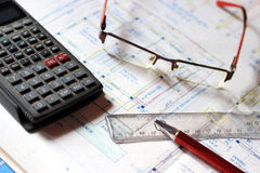 Calculator and building plans. Royalty Free Stock Images