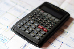 Calculator and building plans. Royalty Free Stock Image