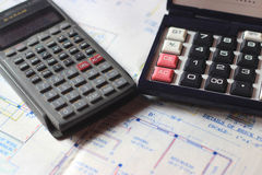 Calculator and building plans. Stock Image