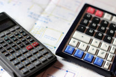 Calculator and building plans. Royalty Free Stock Photography