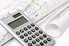 Calculator, building plans Royalty Free Stock Images