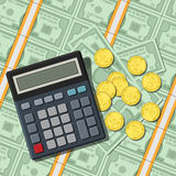 Calculator on bundles of bill and coins Stock Photography