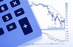 Calculator Business Chart - Crash. Business Chart - Crash, Decreasing Graph, Calculator, Blue Toning Stock Photos