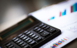 Calculator  with  business charts Stock Photography