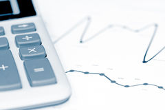 Calculator and business graph Royalty Free Stock Images