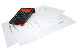 Calculator and business papers on a white background Royalty Free Stock Photography