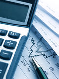 Calculator and business report Royalty Free Stock Photos