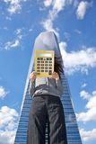 Calculator businesswoman and skyscraper Stock Image