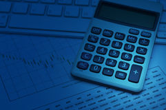 Calculator button plus on keyboard and graph paper, blue tone, a. Ccounting background Stock Photos