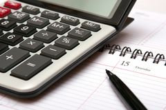 Calculator and calendar. A close up of a calculator and calendar and pen Stock Photo