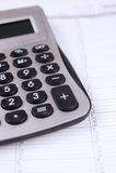 Calculator on a calendar page Royalty Free Stock Photos
