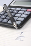 Calculator, calendar and pen Stock Photos