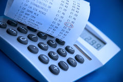 Calculator and cash register receipt Royalty Free Stock Photos
