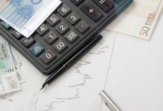 Calculator, chart and the money Stock Photography