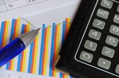 Calculator, chart and pen Stock Images