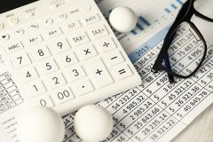 Calculator Charts Rounding Conceptual Balls Numbers. Shallow depth of field. Selective focus Royalty Free Stock Photography