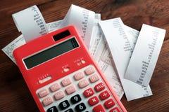Calculator with checks on table stock photos