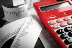 Calculator with checks on table. Tax concept Stock Photos