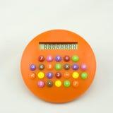 Calculator. A circular orange candy calculator Stock Images