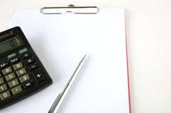 Calculator and clip board Royalty Free Stock Image