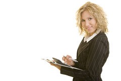 Calculator and clipboard. Blonde business woman with calculator and a clipboard stock images