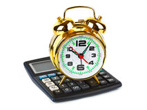 Calculator and clock Royalty Free Stock Photos