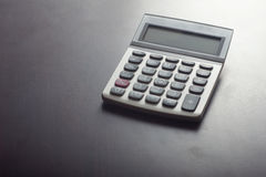 Calculator. Close up of a single calculator on desk Royalty Free Stock Photo