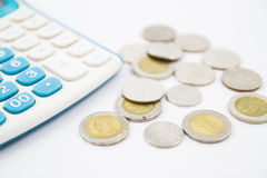 Calculator and coin Stock Image