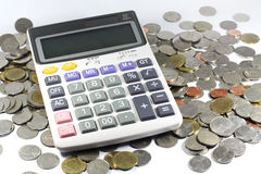 Calculator with coin Stock Image
