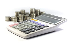 Calculator with coin. On the white background Stock Image
