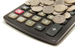 Calculator and coin on the white background Stock Image