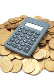 Calculator on coins Royalty Free Stock Photos