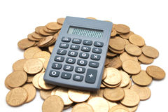 Calculator on coins Royalty Free Stock Photo