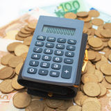Calculator on coins Stock Image