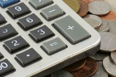 Calculator on coins Royalty Free Stock Images