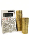 Calculator with coins Stock Image