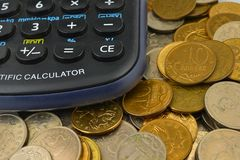 Calculator and coins Stock Photo