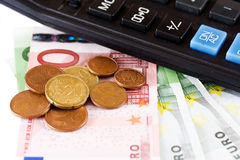 Calculator, coins and a hundred euro bill Royalty Free Stock Photography