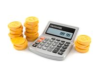 Calculator with coins. Isolated on white background Stock Image